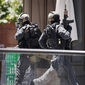 Police storm Sydney cafe to end hostage siege, three dead
