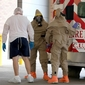 Faced with Ebola, US medics clamor for hazmat suits