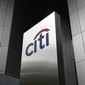 Street brushes off blow to Citi's earnings, but legal woe persists